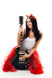 Sexy girl with black guitar and horns Royalty Free Stock Image