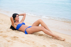Sexy girl with black hair in a bathing suit Stock Images