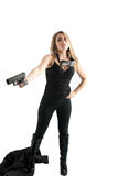 Sexy girl in black pointing a pistol at you. Royalty Free Stock Photo