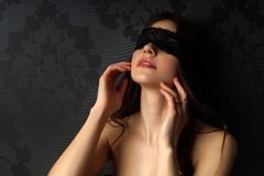 Sexy girl blindfolded. Young beautiful girl with a lace blindfold Stock Images