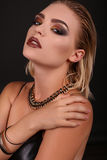 Sexy girl with blond hair and evening makeup,looks like rock star Royalty Free Stock Image