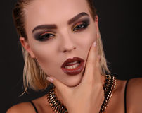 Sexy girl with blond hair and evening makeup,looks like rock star Royalty Free Stock Images
