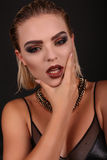 Sexy girl with blond hair and evening makeup,looks like rock star Royalty Free Stock Photography