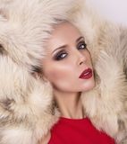 Sexy girl with blond hair in fur coat Royalty Free Stock Photo