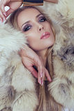 Sexy girl with blond hair in fur coat Royalty Free Stock Images