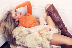 Sexy girl with blond hair in fur coat and boots Royalty Free Stock Photos