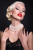 Sexy girl with blond hair in retro style. Sexy girl with blond hair with pearls Stock Photo