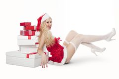 Sexy girl with blonde curly hair dressed as Santa Stock Images