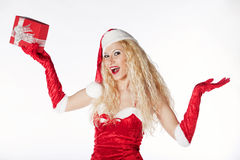 Sexy girl with blonde curly hair dressed as Santa. Portrait of a very sexy blonde girl dressed as Santa's helper, having fun on a Christmas party Stock Photo