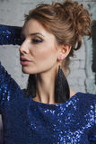 Sexy girl in blue gown and luxury earrings Stock Image