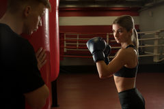 Sexy girl in boxing gloves shot in a gym Stock Photos