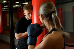 Sexy girl in boxing gloves shot in a gym Stock Images