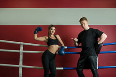 Sexy girl in boxing gloves shot with her boyfriend Royalty Free Stock Images
