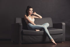 Sexy girl in bra and jeans Stock Photos