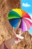 girl with a bright umbrella royalty free stock photos