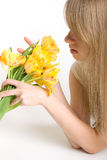 girl with bright yellow tulps Royalty Free Stock Images