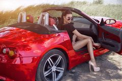 Sexy girl on a cabrio. traveling by car with a beautiful girl hitchhiking fun. Sexy girl on a cabrio. traveling by car with a beautiful girl hitchhiking Royalty Free Stock Photos