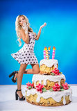 Sexy girl with cake Royalty Free Stock Image