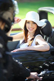 Sexy girl in car looking a man Stock Photography