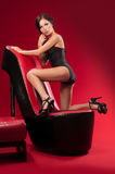 Sexy girl on a chair Stock Photos