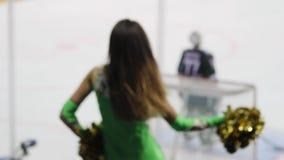 Sexy cheerleader dances near modern ice arena slow motion