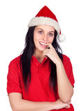 girl with Christmas hat biting her finger Royalty Free Stock Images