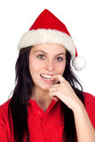 girl with Christmas hat biting her finger Royalty Free Stock Image