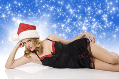 Sexy girl with christmas hat laying Stock Image