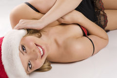 Sexy girl with christmas hat laying Stock Images