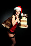 Sexy girl with Christmas presents Royalty Free Stock Photos