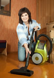 Sexy girl cleans with vacuum cleaner Royalty Free Stock Photos
