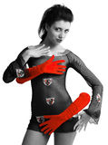 Sexy girl closed with strange hands in red gloves Stock Photo