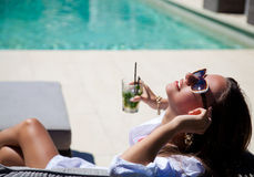 Sexy girl with a cocktail near the pool Stock Photography