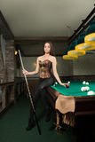 girl in corset plays billiards. Stock Photography