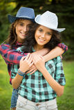 Sexy girl in cowboy hats and plaid shirts Royalty Free Stock Photos