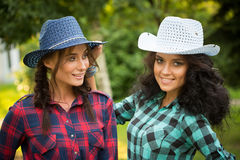 girl in cowboy hats and plaid shirts Royalty Free Stock Images