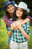 Sexy girl in cowboy hats and plaid shirts Stock Photo