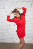 girl in crimson  dress Stock Photo