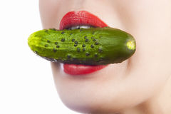 Sexy girl with cucumber Stock Images