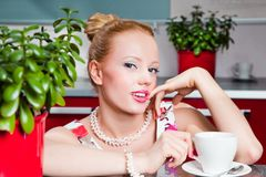 Sexy girl with cup of morning coffee in interior o Stock Image