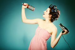 Sexy girl in curlers with hairdryer styling hair Royalty Free Stock Images