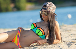 Sexy girl with dark hair on the beach Royalty Free Stock Photo