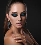 Sexy girl with dark hair and evening makeup with bijou Stock Image