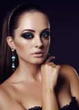 Sexy girl with dark hair and evening makeup with bijou. Fashion studio portrait of beautiful sexy girl with dark hair and evening makeup with bijou Royalty Free Stock Photos