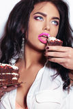 Sexy girl with dark hair and tanned skin, holding delicious cake Stock Photos
