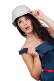 Sexy girl in a deflated coverall and helmet Stock Image
