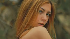 girl in dense forest video old dry branches outdoors slow motion