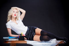 Sexy girl on the desk Stock Images