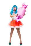 Sexy girl doll with blue hair. huge candy in the Stock Photography