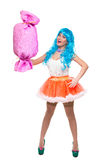 Sexy girl doll with blue hair. huge candy in the Royalty Free Stock Image